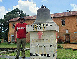 Jan, one of our drivers, standing next to the Livingstonia Synod