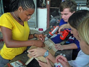 teens hard at work building a solar power system