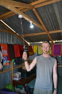 Sam testing his handy work after installing a solar power system to a poor rural home in Kenya